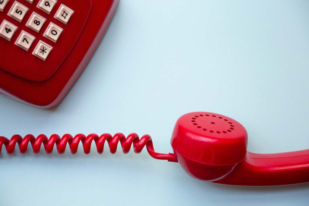 a red touch-tone phone