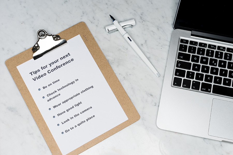 bullet point list written on paper on a clipboard